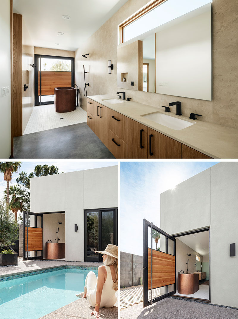 This modern master bathroom features honed marble , a walk-in shower area, a copper soaking tub, and a custom pivoting door that opens to a courtyard. #MasterBathroom #BathroomDesign #PivotingDoor