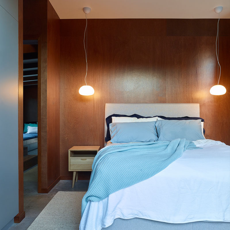 In this bedroom, two simple pendant lights hang above bedside tables on either side of the bed. #BedroomDesign