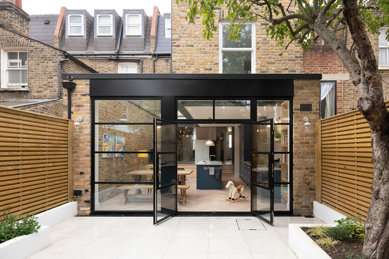 British firm Sketch Architects, have completed the refurbished a terraced home in South West London by adding a spacious, bright rear extension, that features a large glass door extending into the garden, and a usable, playful basement room. #ModernHouseExtension #Extension #Architecture