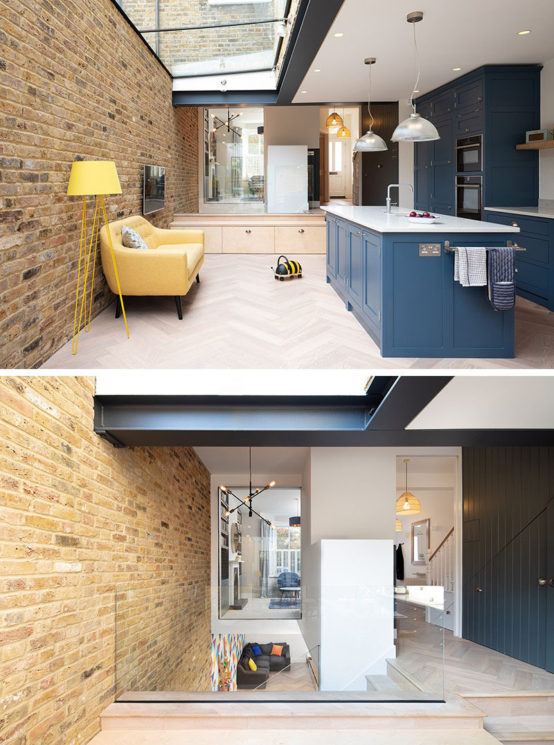 In this modern house extension, glass safety rails that provide protection from the stairs leading to the basement, and a window that gives glimpse of the front reception room from the original house. #ModernHouse #ModernExtension