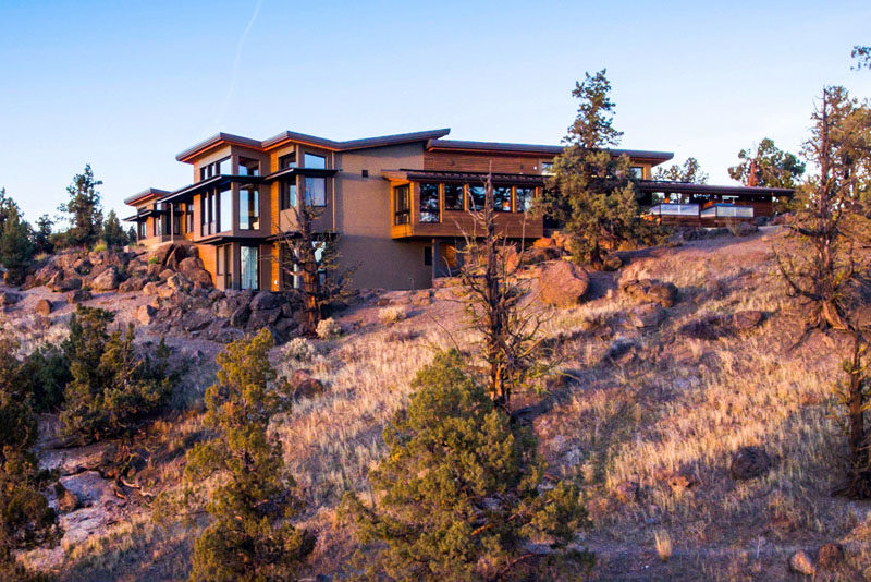 Nathan Good Architects has designed a new contemporary house that's nestled into a bluff above the scenic Deschutes River in Central Oregon. #ModernHouse #ModernArchitecture #HouseDesign