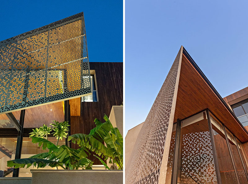 This modern house features a large decorative screen that provides privacy for the interior without blocking the natural light. #PrivacyScreen #Architecture