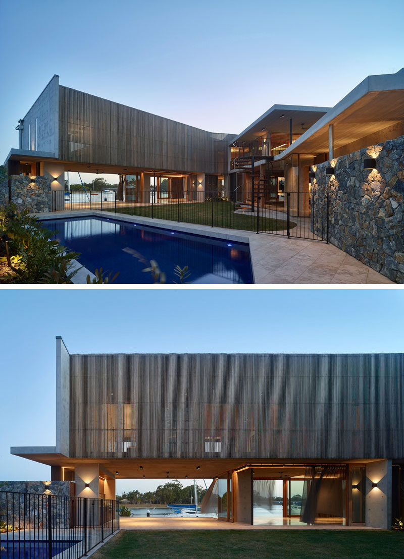 This modern house in the shape of a 'V' employs a simple 'courtyard home' concept, with the house embracing the irregular-shaped site boundaries to leverage the north-east orientation to the courtyard and connect to the water's edge on the south. #ModernHouse #WoodScreen #Courtyard