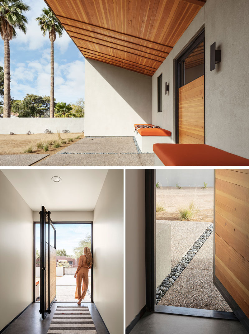 At the front of this modern house is a semi-private courtyard with woven wood ceiling and bench seating on either side of a pivoting front door. #FrontDoor #Landscaping
