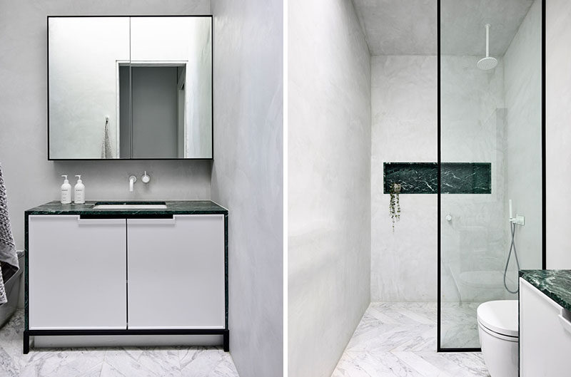 In this modern master bathroom, a simple black framed shower screen separates the shower with a built-in shelf, from the vanity and toilet. #MasterBathroom #BathroomDesign #ModernBathroom