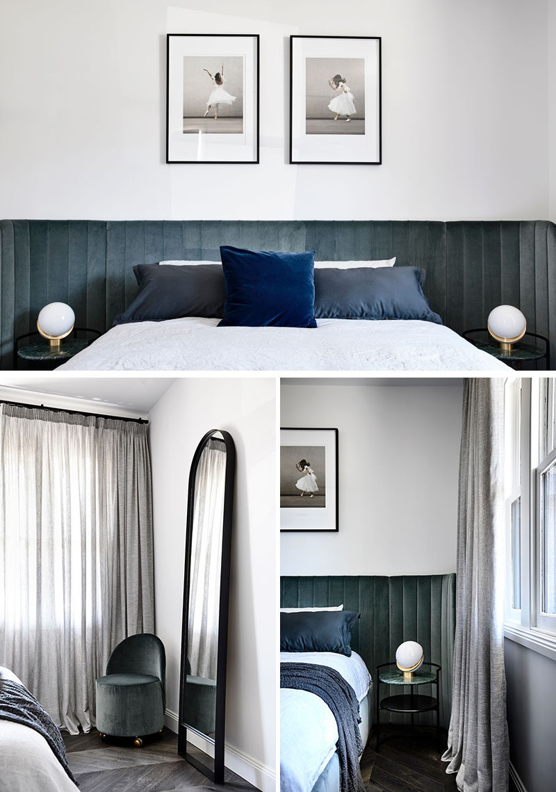 A wall-to-wall velvet upholstered headboard adds a soft touch of color to this contemporary bedroom. #BedroomDesign #Bedroom