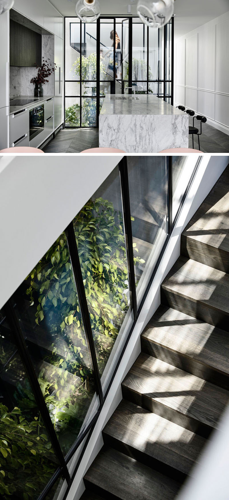 A plant-filled, glass-enclosed atrium opens up the center of this modern house and allows for views between the kitchen and staircase to the children's bedrooms upstairs. #Atrium #InteriorDesign #Stairs #Windows #Architecture