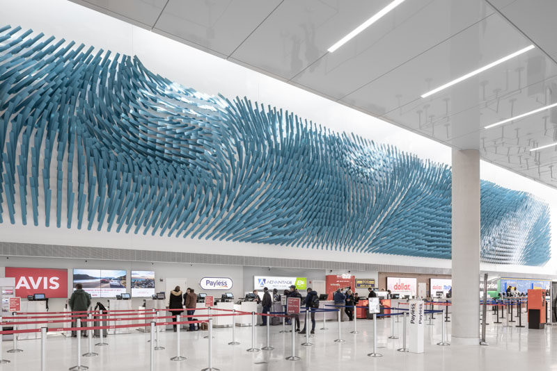 Artist Rob Ley has created 'Field Lines', a large art installation at O'Hare Airport Transit Hub in Chicago, Illinois, that's designed to evoke the flow of a steady breeze in a field. #Art #Sculpture #Design