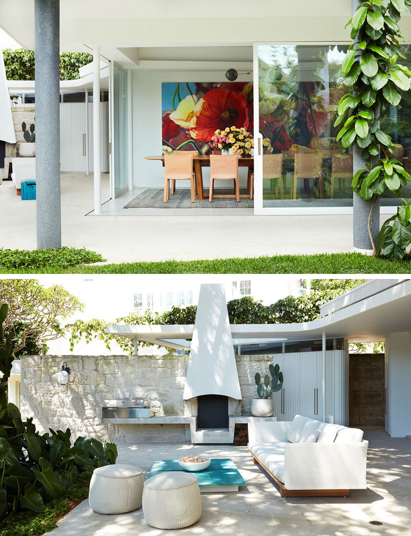 Floor-to-ceiling steel and glass windows, connecting the interior of this modern house to the outdoor spaces, like an lounge with a bbq area. #SlidingGlassDoors #OutdoorLounge