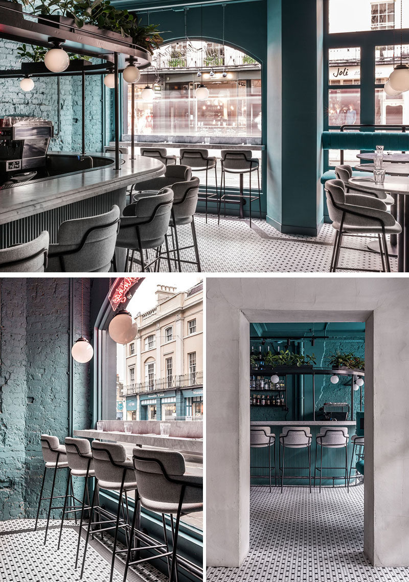 The Green Room is an intimate cocktail bar with a deep-turquoise-blue backdrop and elegant stools around the bar and window. #ModernBar #BarDesign #Stools
