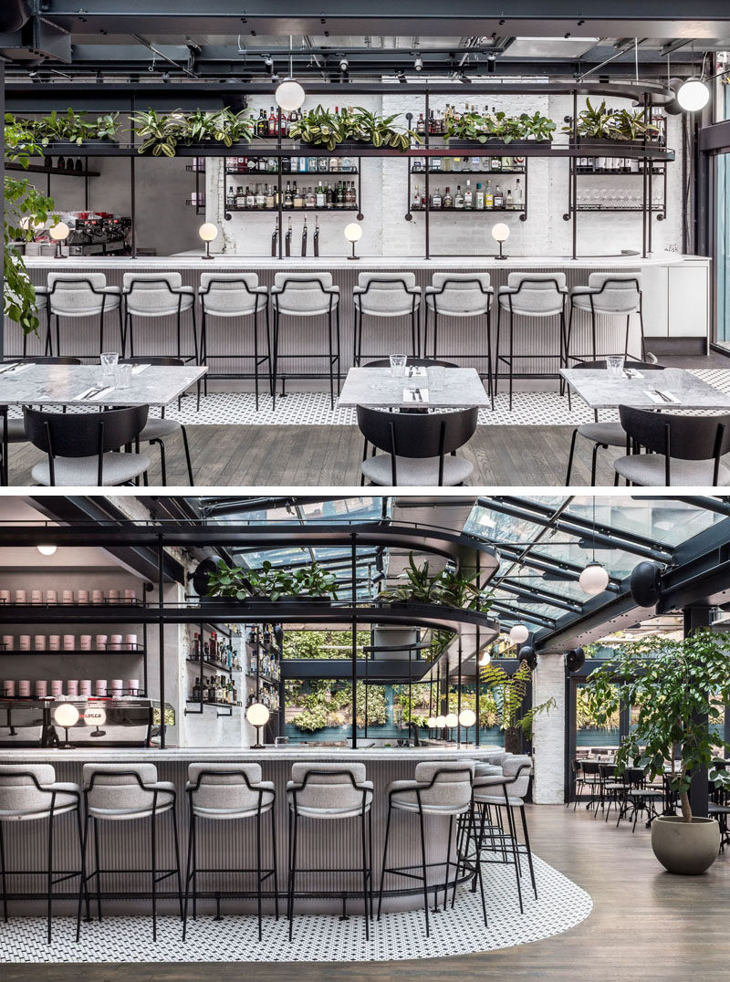 This modern restaurant features a variety of seating, including a bar seating, a communal table, dining tables and banquettes. #RestaurantBar #RestaurantDesign