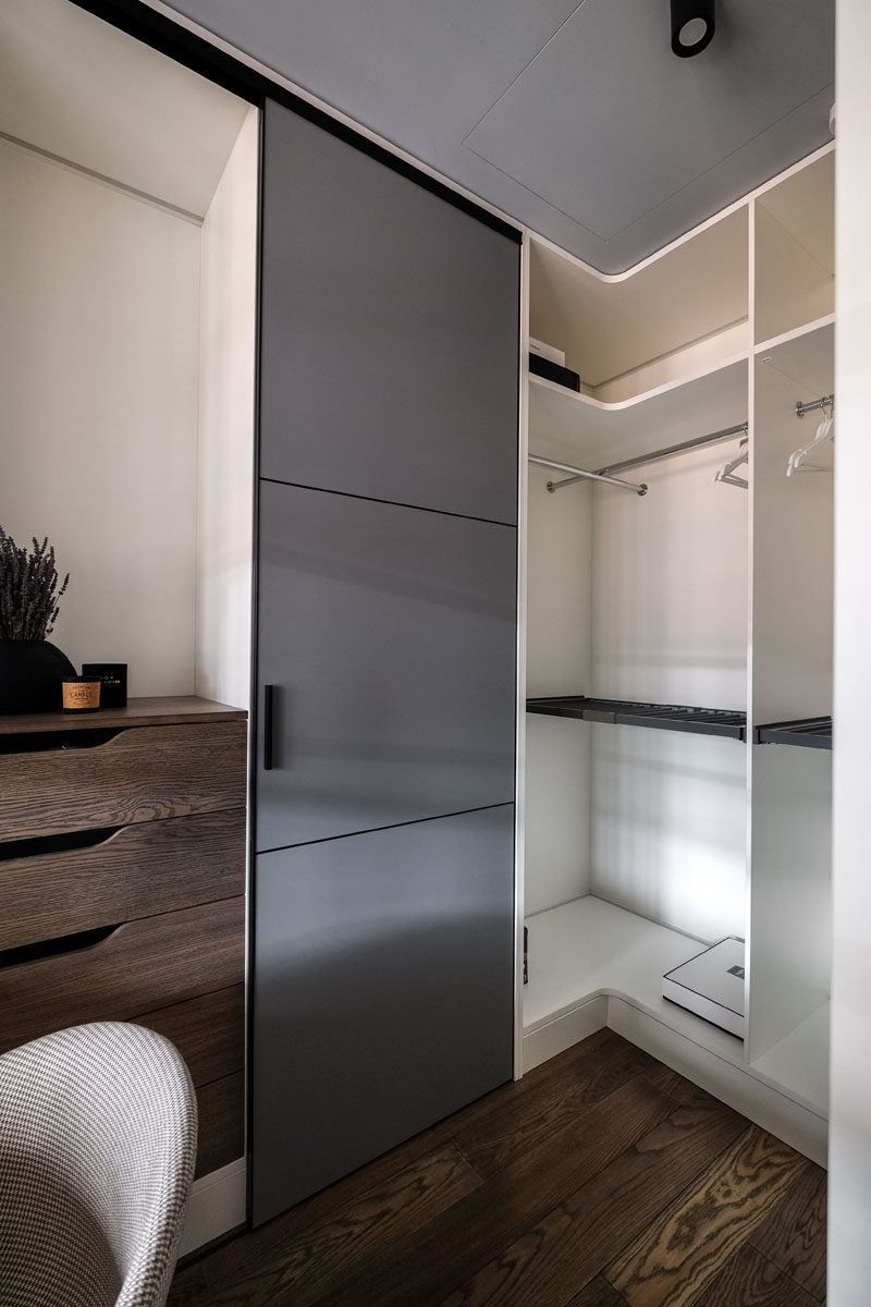This modern closet has floor-to-ceiling cabinets and a small home office area. #Closet #Shelving