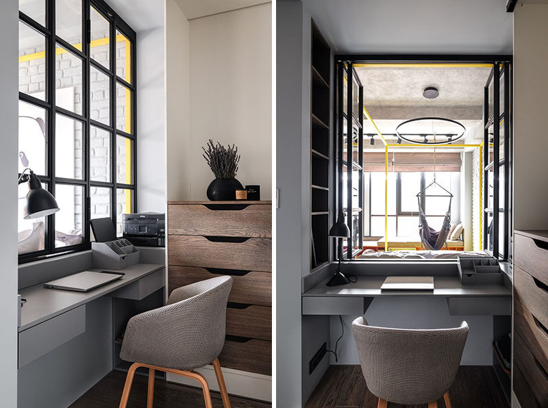 Black-framed windows have been installed in this small and modern apartment to allow the natural light from the main windows to reach through to the home office. #HomeOffice #InteriorWindow