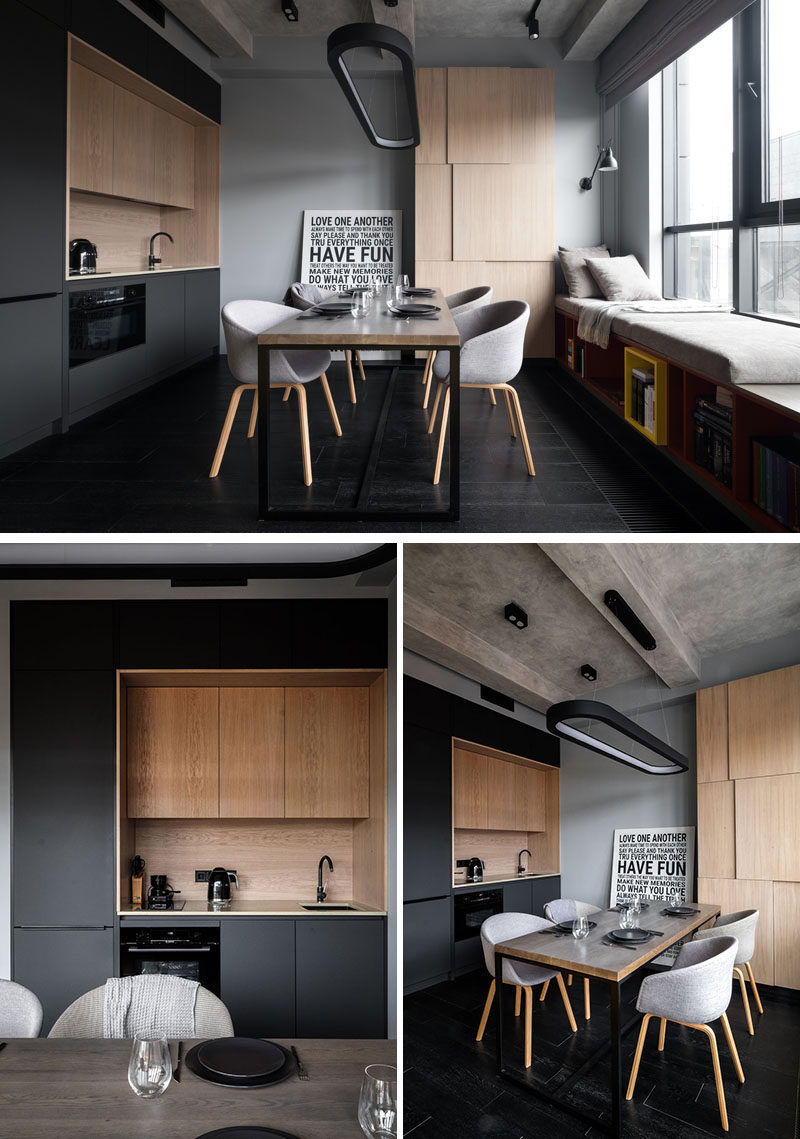 In this small and modern apartment, a minimal matte black kitchen with wood accents was added to the wall, while a dining table provides additional food prep space and a place to dine. #BlackKitchen #DiningRoom #ModernApartment #SmallKitchen