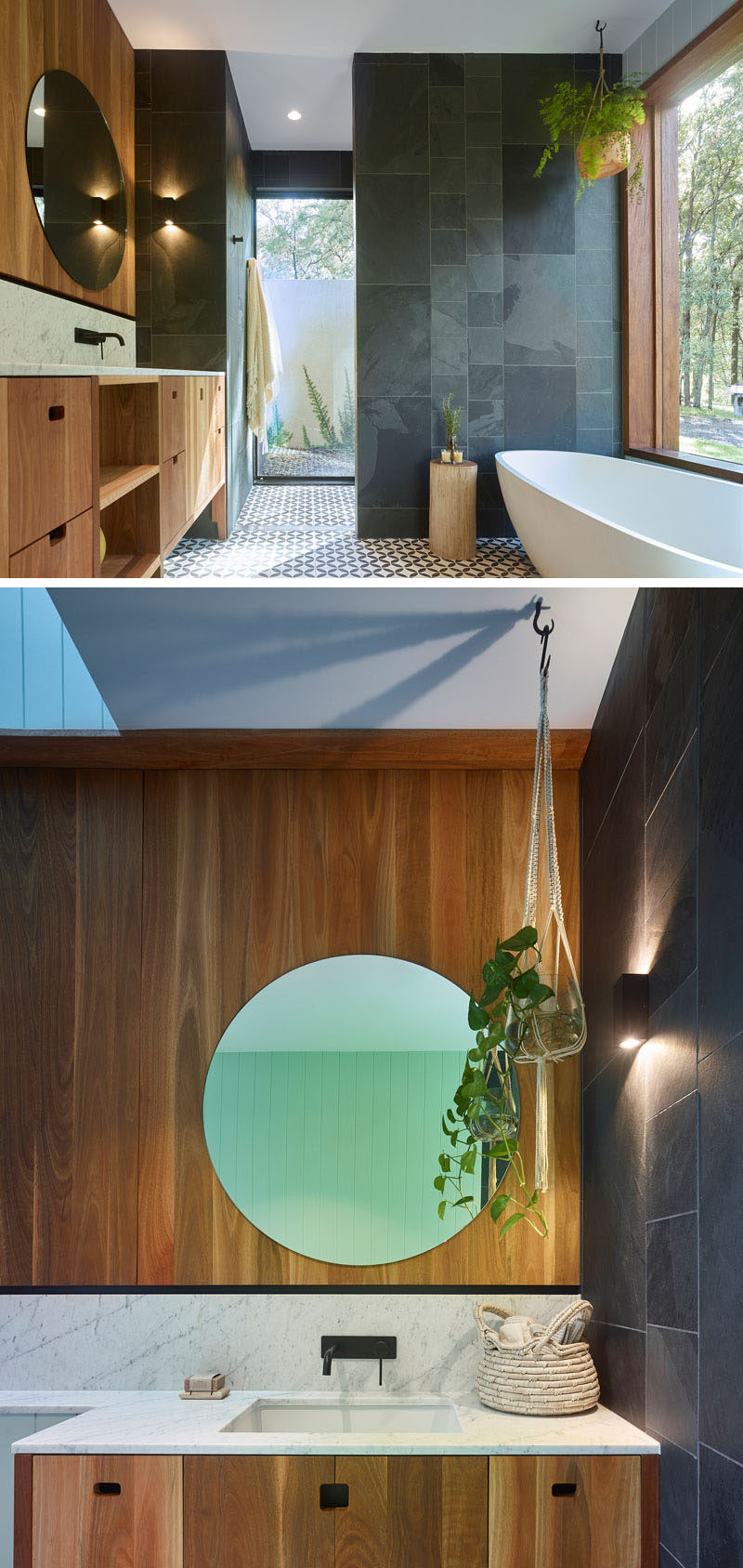 In this modern bathroom, a partially frosted glass panel provides privacy in the shower without blocking the light, while a large window beside the bathtub gives views of the trees. #BathroomDesign #ModernBathroom