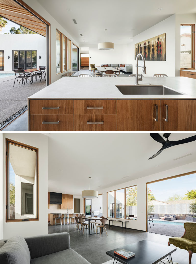 The main social areas of this modern house are all open plan, with the dining area separating the living room from the kitchen. #ModernInteriorDesign #OpenPlanInterior #InteriorDesign