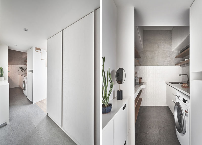 Stepping inside this small and modern apartment, there's an entryway that looks towards the kitchen, and a hidden closet hidden behind large plain white doors. #TinyLiving #SmallApartment