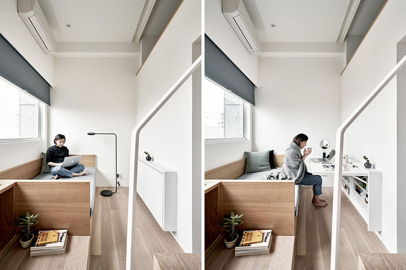 In the living room of this small apartment, there's a couch which can also be used as a guest bed, and a wall unit that opens to a desk or dining table. #LivingRoom #TinyLiving #SmallApartment
