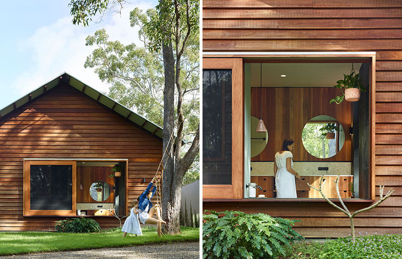 This modern house has a large sliding window that gives the bathroom a view of the backyard. #Window