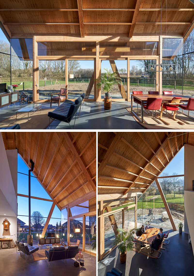 Inside this modern barn-style house, the high gable roof allows plenty of natural light to flood the interior of the home through floor-to-ceiling windows on three sides of the open plan living room and dining room. #Windows #Architecture #WoodCeiling