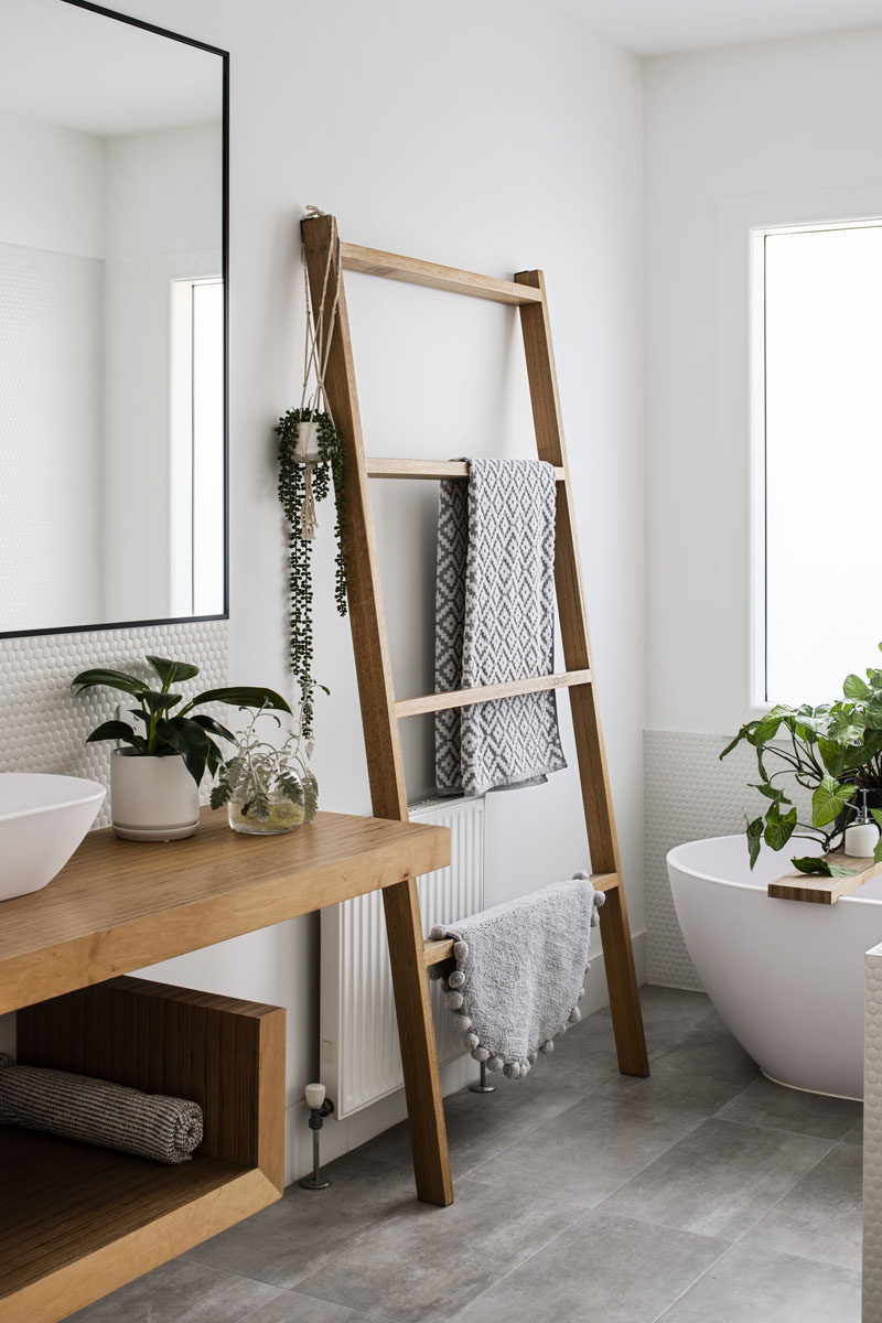 This updated and modern bathroom was kept simple with the use of a neutral color palette and natural materials. #ModernBathroom #BathroomDesign