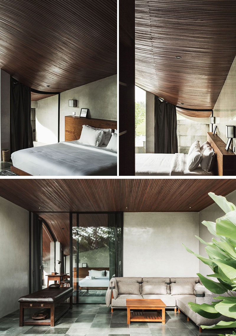This modern bathroom showcases the curved wood ceiling, while a sliding glass door opens the bedroom up to a private patio area. #WoodCeiling #CurvedCeiling #Bedroom #Patio