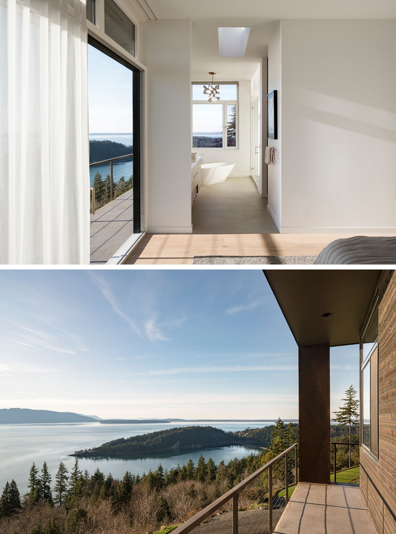 This modern master bedroom has a sliding door that opens up to a balcony, while the master bathroom has the freestanding bathtub positioned diagonally in the corner to take advantage of the views. #MasterBedroom #Balcony #MasterBathroom