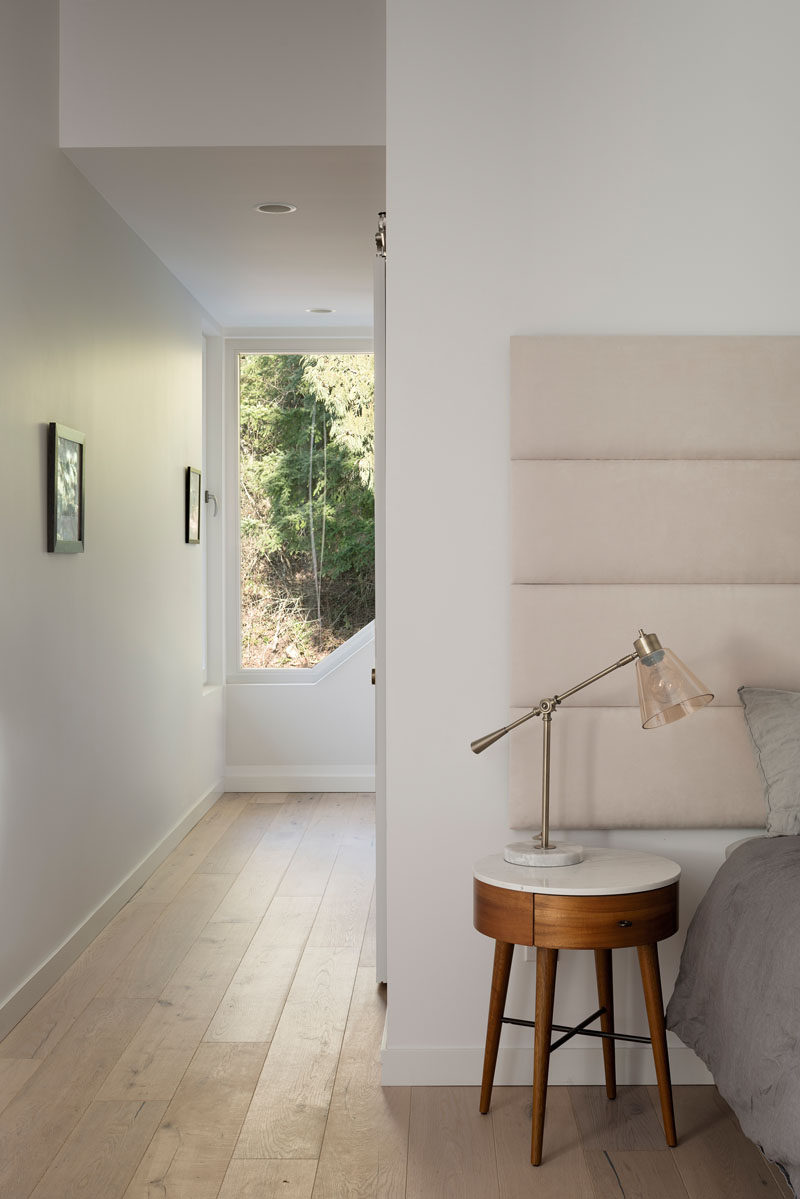A tall window allows natural light to fill the hallway to the master bedroom and helps to create a calming atmosphere. #MasterBedroom #Window #Hallway