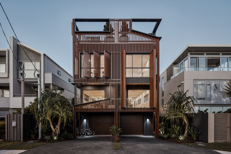 This Duplex Is Covered In Vertical Wood Fins And Large Shutters