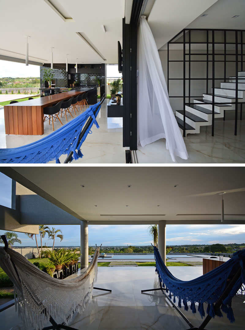 This modern house has a pair of freestanding hammocks, that provide a place to relax and enjoy the breeze and pool views. #Hammocks #ModernHouse
