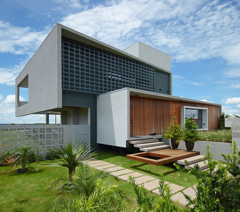 Giordano Rogoski Architects has designed a modern house in Rolim de Moura, Brazil, that's located on a lot with a slope of more than 32 feet (10m) between the front and the back. #ModernHouse #ModernArchitecture #HouseDesign