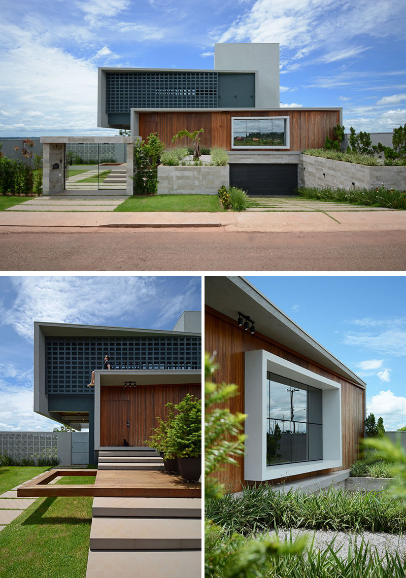 At the front of this modern house, the garage has been sunken down under the house, while the landscaping helps to guide visitors to the front door. #ModernHouse #SunkenGarage #Landscaping