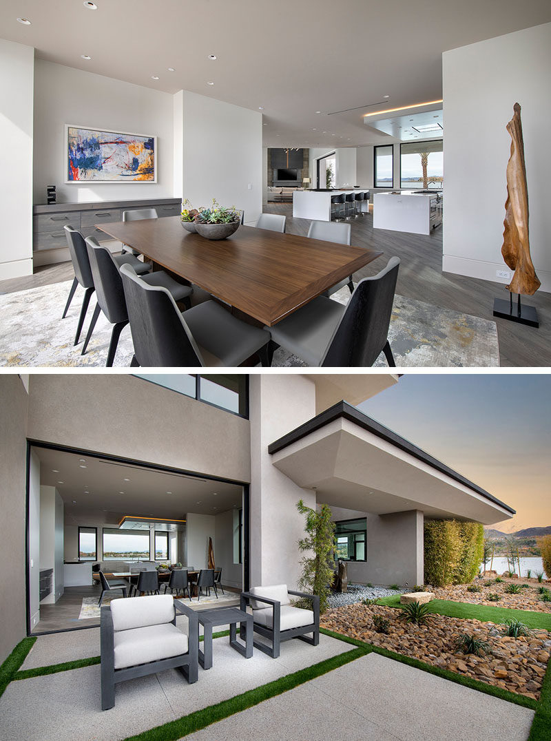 This modern dining room has a built-in floating sideboard, and opens to a small patio with a couple of armchairs. #DiningRoom #ModernDining #Landscaping