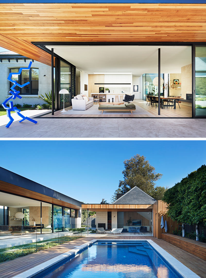 Large overhangs provide the interior spaces of this modern home with shade, assisting in keeping the house cool, while large sliding glass doors open the social areas to the swimming pool. #SwimmingPool #Architecture #ModernHouse