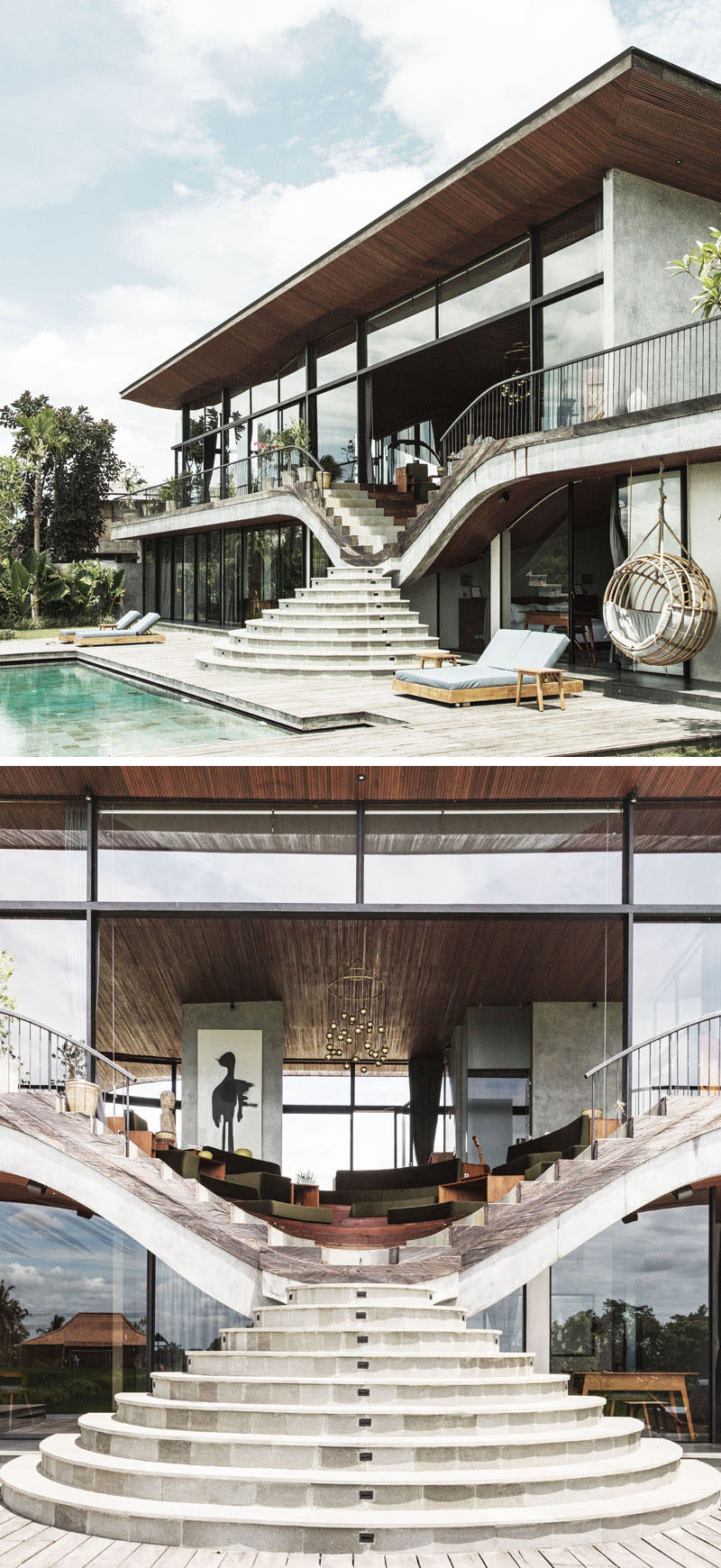 At the rear of this modern house, the swimming pool and lower level of the home are connected to the upper level by a set of curved stairs. #Stairs #StairDesign #ModernHouse