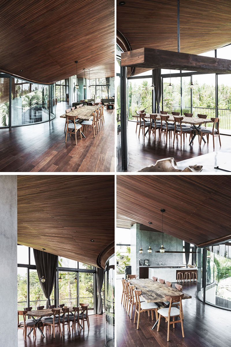 The curved wood ceilings in the dining area of this modern house mimic the lines of the roof, with the designer explaining that it should feel 'like being inside of an instrument'. #DiningRoom #WoodCeiling #CurvedCeiling