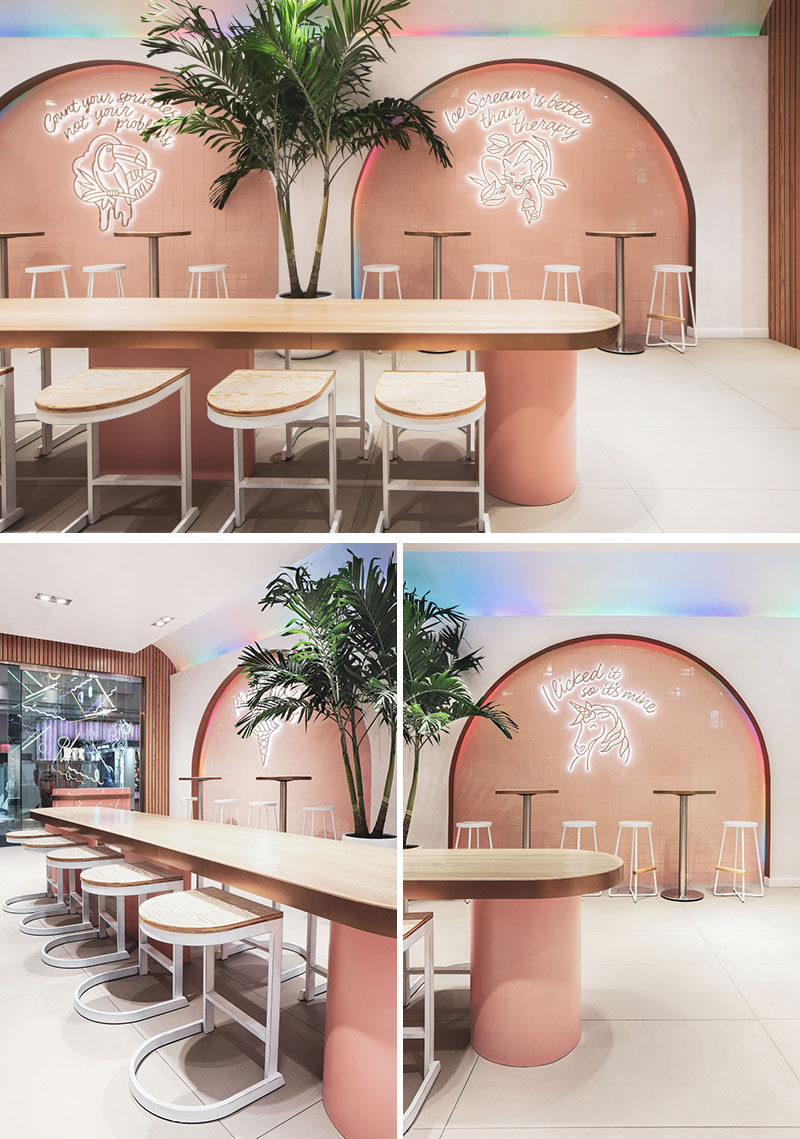 This modern ice cream parlor features four main arches that are accented by multicolored led lighting slowly alternate hues, creating perpetual movement and framing the neon signs. #IceCreamParlor #Arches #RetailDesign #InteriorDesign