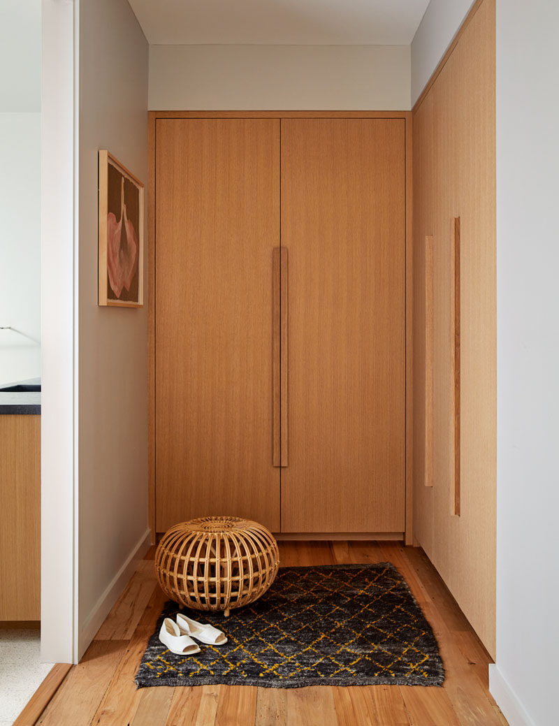This renovated house has a dressing area with custom wood cabinets. #DressingArea #InteriorDesign #Closet