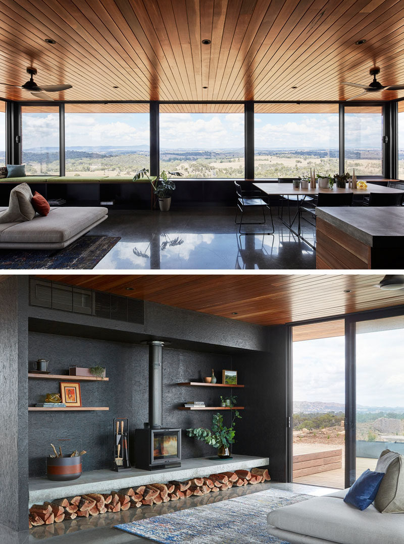 The large canopy overhangs and eaves are deep, allowing this modern house to be protected against the sun and winds. Inside the home, palette is dark and moody, with wood, dark materials, and concrete heavily featured. #FirewoodStorage #Windows #WoodCeiling #Fireplace