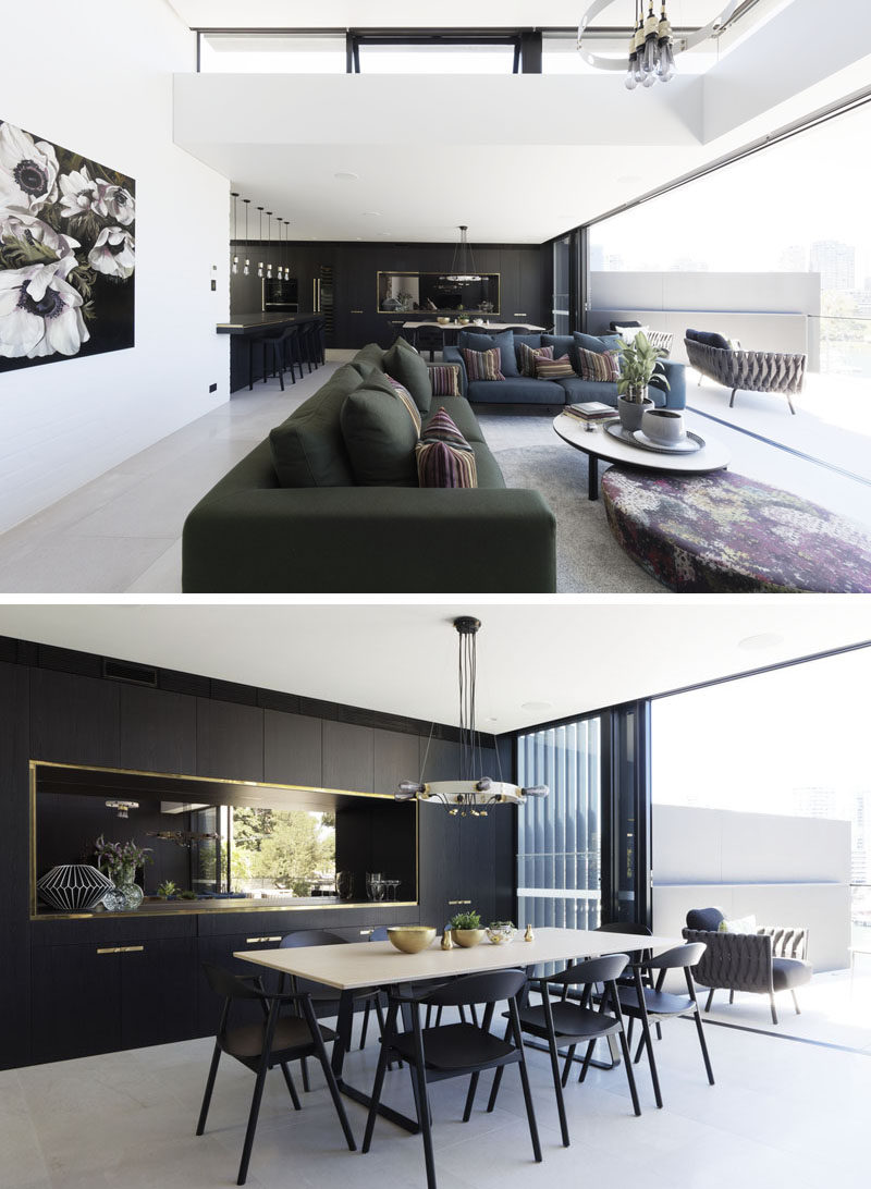The social area of this modern house is open plan, with the living room, dining area, and kitchen all enjoying the natural light from thebalcony. #LivingRoom #ModernDiningRoom