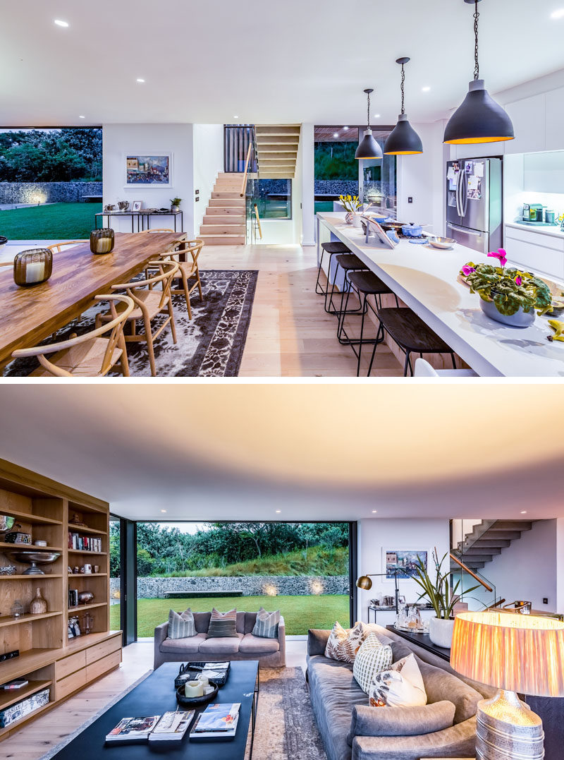 Inside this modern house, the bright and welcoming interiors are laid out with an open floor plan, ideal for entertaining, with multiple places to access backyard on one side. #OpenPlanInterior #Kitchen #DiningRoom #LivingRoom