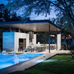 This Poolside Living Room And Kitchen Sits Under A Large Floating Canopy