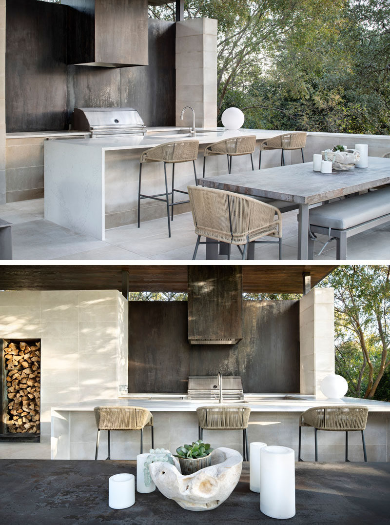 Oxidized steel panels have been used behind the grill in this modern outdoor kitchen. #OutdoorKitchen