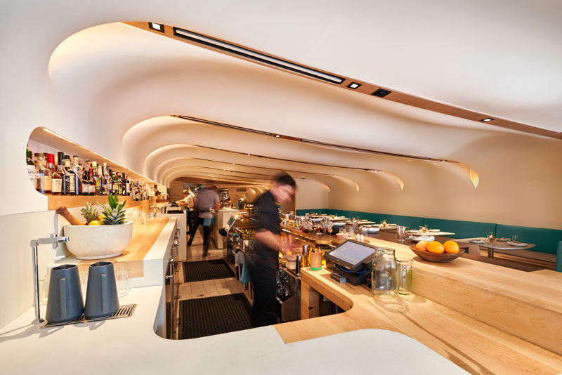 Canadian architecture studio PARTISANS, has recently completed Quetzal, a new modern restaurant in Toronto, whose design has been inspired by the billowing tarps ofMexico's mercados (market stalls). #Restaurant #RestaurantDesign #InteriorDesign #RestaurantInterior
