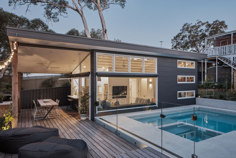 A bare backyard was transformed into a new small house with a pool for a family of four. #SmallHouse #SwimmingPool #TinyLiving