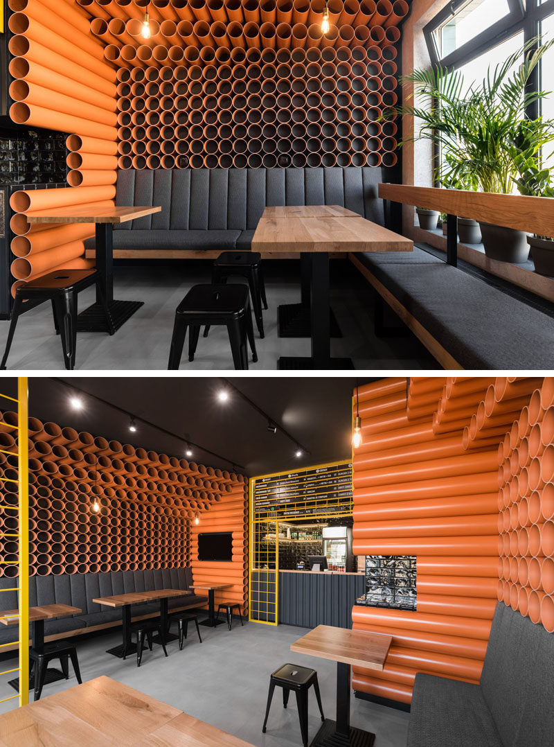 Architecture and interior design firm mode:lina, has recently completed ChiChi 4U, a modern burger restaurant in Poznan, Poland, whose interior is filled with materials that came straight from a building supplies warehouse, like orange PVC pipes and corrugated metal. #RestaurantInterior #BurgerRestaurant #InteriorDesign #ModernRestaurant