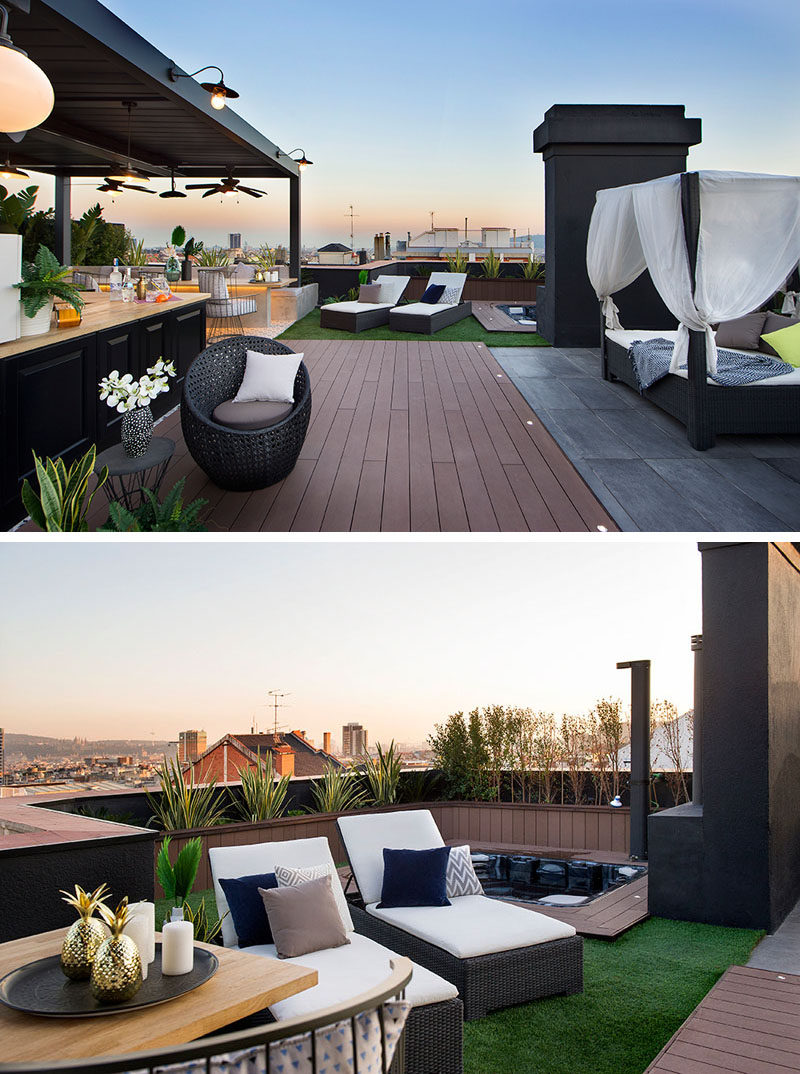 This modern rooftop terrace has a variety of seating areas, a sunken hot tub with an outdoor shower, and a covered kitchen and dining area. #RooftopTerrace #RooftopDeck #SunkenHotTub