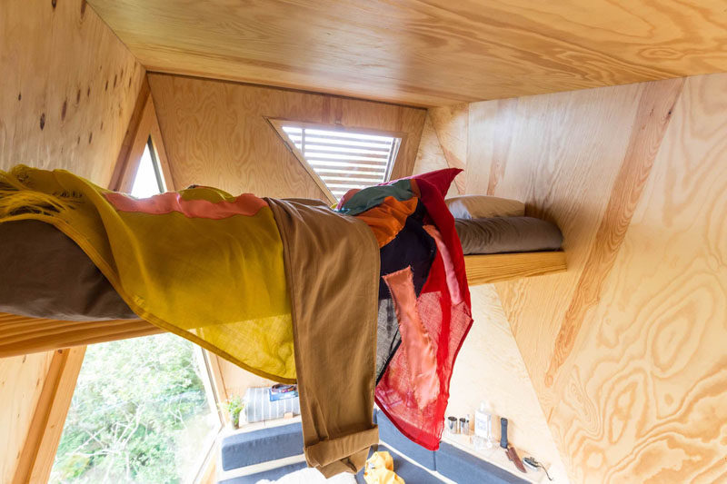 This tiny cabin has a sleeping loft perched between the angled walls. #SleepingLoft #TinyCabin