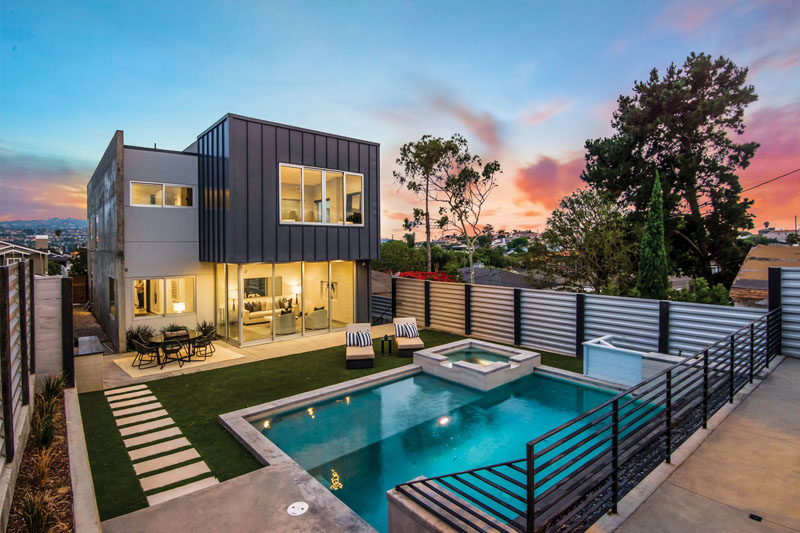 Located in Redondo Beach, California, the Avenue A Residence is focused on maximizing the views and natural lights, while the backyard is ideal for entertaining. #ModernHouse #ModernBackyard #ModernSwimmingPool #ModernLandscaping