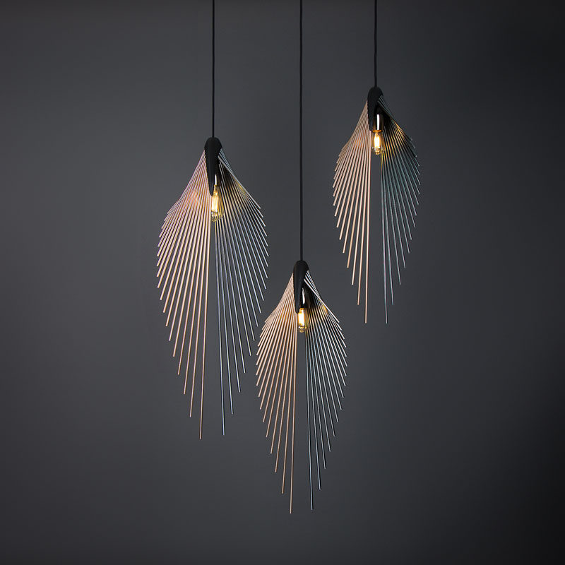 This modern pendant light's shape is defined by the anodized aluminium poles, fixed in a 3D printed holder, following a V-shaped geometry, while an Edison Vintage LED bulb completes the appearance. #ModernLighting #LightingDesign #PendantLighting